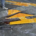 ตีเส้นลูกศรสีเหลือง อาคารกรุงเทพประกันภัย