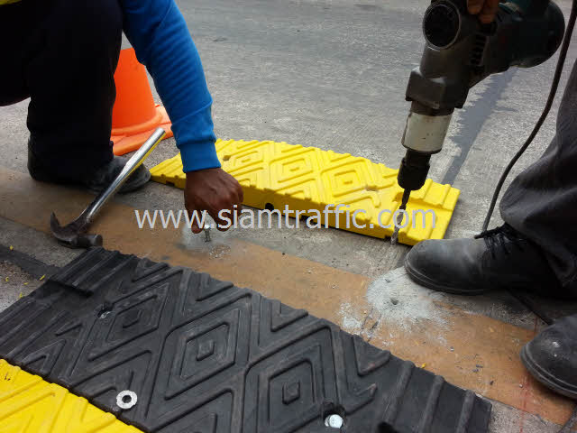 Installation of yellow and black plastic speed bump at Chachoengsao Province