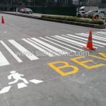 การตีเส้นจราจรบนถนน และทาสีข้อความ แกรนด์ พระราม 9