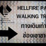 """ป้ายลูกศร """"ทางเดินเท้าไปช่องเขาขาด HELLFIRE PASS WALKING TRAIL"""""""