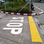 """ตีเส้นจราจร ข้อความ """"STOP"""" บริษัท โตโยต้า มอเตอร์ ประเทศไทย จํากัด โรงงานบางปะกง"""