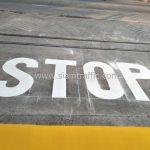 """ตีเส้น ข้อความ """"STOP"""" บริษัท โตโยต้า มอเตอร์ ประเทศไทย จํากัด โรงงานแบริ่ง"""